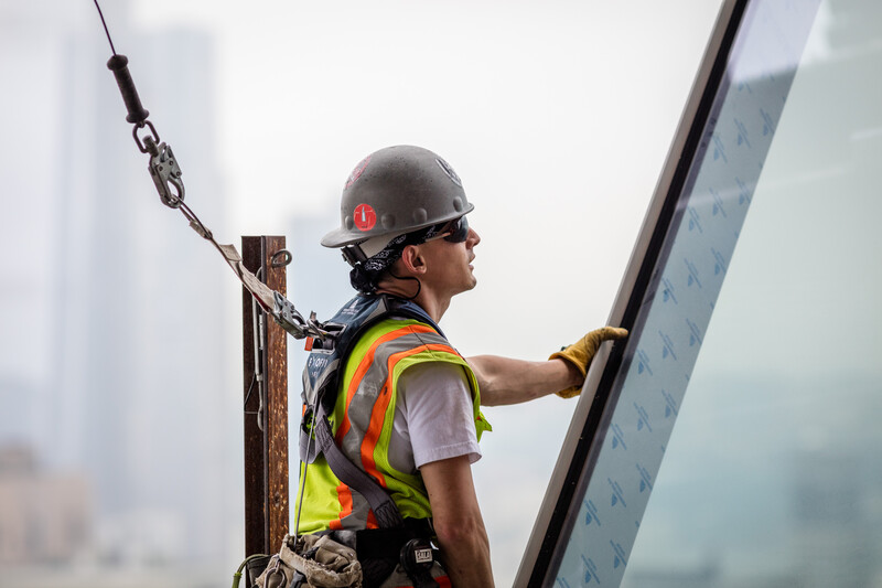 Construction worker taking a break on top of a building project
